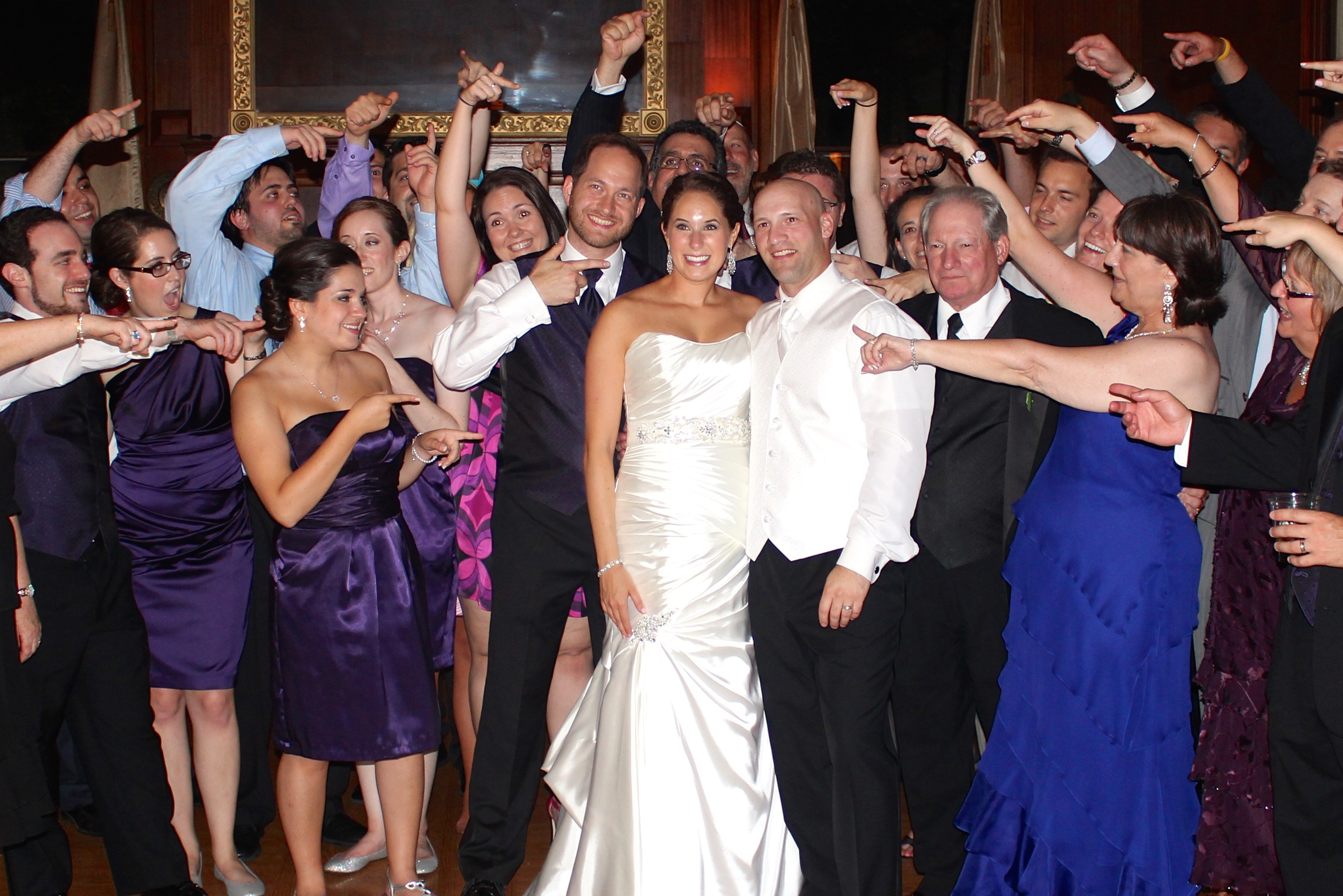 Wedding-bride-and-groom-with-friends-waving-goodbye-baltimore-wedding-dj